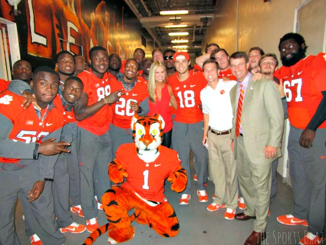 with Clemson football team and coach